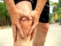 People with knee pain and feeling bad hand on he knee, healthy concept.  stock image