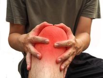 People with knee pain and feeling bad hand on he knee, healthy concept.  stock photos