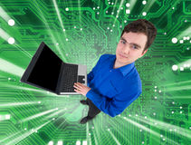 People with laptop on electronic green background Stock Photo