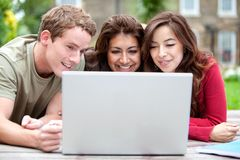 People on a laptop outdoors Royalty Free Stock Images