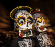 People with Large Masks in Dia De Los Muertos Procession Royalty Free Stock Photos
