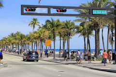 People on A1A at Las Olas Boulevard. FORT LAUDERDALE, FLORIDA - FEBRUARY 3: Las Olas Boulevard has restaurants that serve food outdoors, shopping opportunities Royalty Free Stock Photo