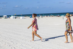 People in late afternoon are going to leave the beach Royalty Free Stock Photography