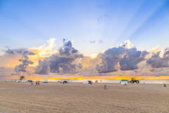 People in late afternoon walk along south beach and enjoy the su Royalty Free Stock Photo