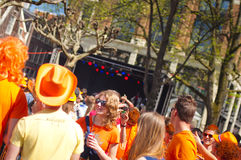 People laughing at King's day Royalty Free Stock Photography