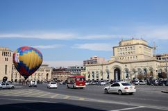 People launching balloon near the Government building on Republic square,Erevan. EREVAN,ARMENIA - MARCH 8: People launching balloon near the Government building Royalty Free Stock Image