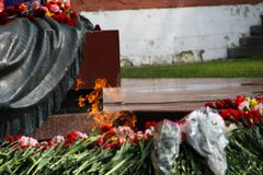 People lay flowers at the Eternal flame in Aleksandrovsk to a garden in the Victory Day Royalty Free Stock Images