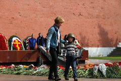 People lay flowers at the Eternal flame in Aleksandrovsk to a garden in the Victory Day Royalty Free Stock Photo