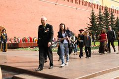 People lay flowers at the Eternal flame in Aleksandrovsk to a garden in the Victory Day Royalty Free Stock Image