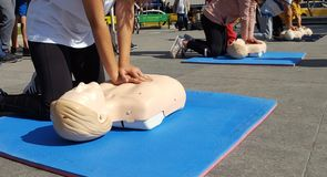 People learning how make first aid heart compressions stock image