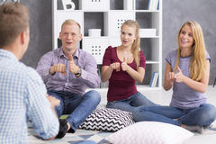 People learning sign language Stock Images