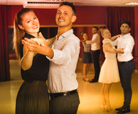 People learning to dance waltz in dancing class. Happy positive people learning to dance waltz in dancing class Stock Photo