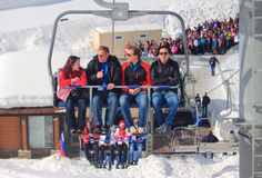 People leave sporting object by chairlift Stock Images