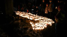 People leaving candles on memorial at Kalevankangas Cemetery stock footage