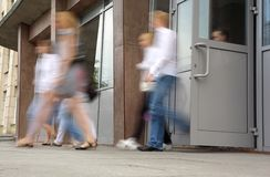 People leaving doors Royalty Free Stock Image