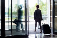 People Leaving Hotel Stock Photography