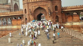 People leaving the jama masjid friday mosque after the friday prayers old stock video
