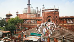 People leaving the jama masjid friday mosque after the friday prayers old stock video footage