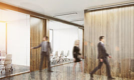 People leaving meeting room. People leaving conference room after the meeting is over. Concept of pointless business routine. 3d rendering. Mock up. Toned image Stock Image