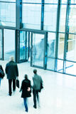 People Leaving an Office Building, Motion Blur. A people rushing through corridor Stock Photo