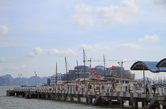 People are leaving pier for tourist ferries in Ha Long bay, Vietnam Stock Photo