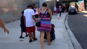 People leaving Vancouver aquarium. stock video footage