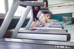 People legs in motion during a treadmill training Stock Images