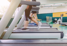 People legs in motion during a treadmill training Stock Photography