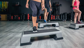 People legs over steppers training in aerobic Royalty Free Stock Photos