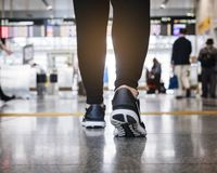 People legs walking in train station Travel concept stock photos