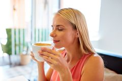 Close up of woman drinking coffee at restaurant Stock Images