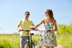 Happy couple with bicycles on country road royalty free stock photos