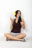 People, leisure and technology concept - woman in headphones, smartphone. Royalty Free Stock Photos
