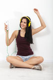 People, leisure and technology concept - woman in headphones, smartphone. Royalty Free Stock Image
