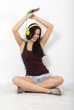 People, leisure and technology concept - woman in headphones, smartphone. Stock Photo