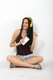 People, leisure and technology concept - woman in headphones, smartphone. Royalty Free Stock Photo