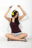 People, leisure and technology concept - woman in headphones, smartphone. Stock Images
