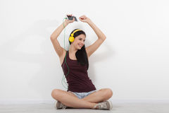 People, leisure and technology concept - woman in headphones, smartphone. Royalty Free Stock Photography