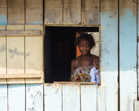People in LIBREVILLE, GABON. LIBREVILLE, GABON - MAR 6, 2013: Unidentified Gabonese woman looks trough the open window in Gabon, Mar 6, 2013. People of Gabon Stock Photography