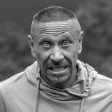 People and lifestyle concept. Middle-aged unshaven man outdoor, emotional portrait close up. Black and white Royalty Free Stock Photo