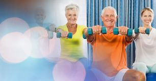 People lifting dumbbells in gym. Digital composite of People lifting dumbbells in gym Stock Image