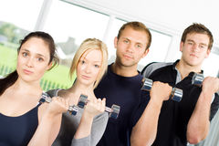People lifting weights Stock Images
