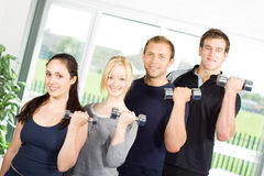 People lifting weights Royalty Free Stock Image