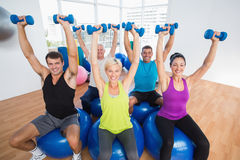 People lifting weights in gym class Royalty Free Stock Photography