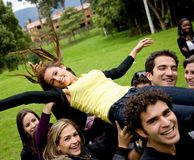People lifting a woman Stock Photography