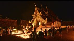 People light candles and pray at the Ton Kwen Temple on Visakha Bucha day, Chiangmai, Thailand. (Move Right-Left)
