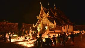 People light candles and pray at the Ton Kwen Temple on Visakha Bucha day, Chiangmai, Thailand. (Zoom-Out)