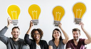 People with lightbulb icon isolated Stock Photos