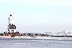 Lighthouse of Marken and drfting ice, Netherlands Royalty Free Stock Image