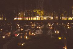 People lighting candles in the Kalevankangas cemetery in Tampere Stock Images